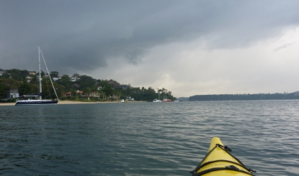 Paddling into the uppming storm on Sydney Harbour