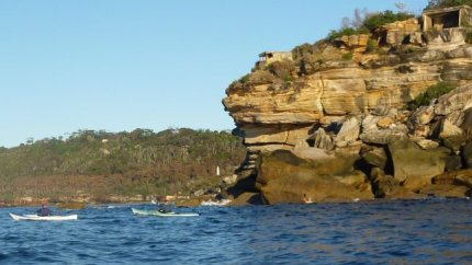 Paddlers crossing past the ocean side of Middle Head - Sydney Harbour