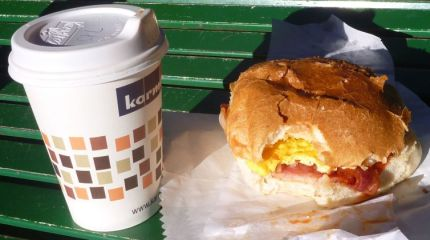 Breakfast of Champions! Fresh coffee, egg and bacon roll with sauce. Yum!