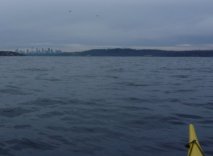 Looking back at the Sydney skyline from sea