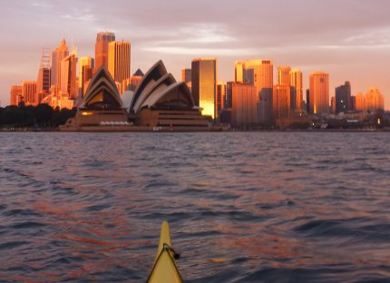 Rising sun reflected in the Sydney city skyline