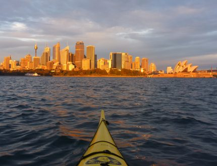 Sunrise bathing the Sydney city in amber