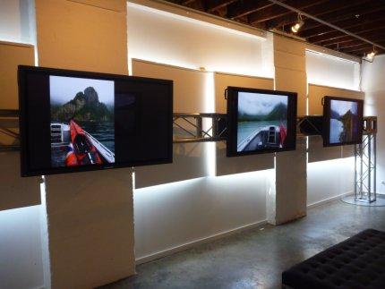 Bloody big Panasonic flat-screens with photos of Alaska