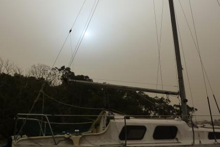 Sunrise through the dust, Sydney Harbour