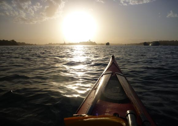 Heading back to my launch point as the sun sets. Note how wet the kayak is!