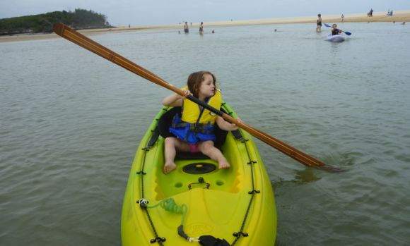 Gracie, aged 3.5, working the Greenland paddle