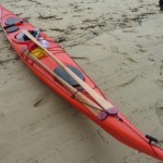 The shorter storm-paddle fits nicely on deck as a spare
