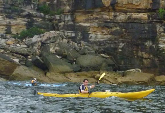 Sacha paddling past Middle Head (with Timbo in the background)
