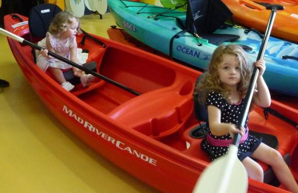 My girls (Miss2 and Miss3) trying out a canoe for size