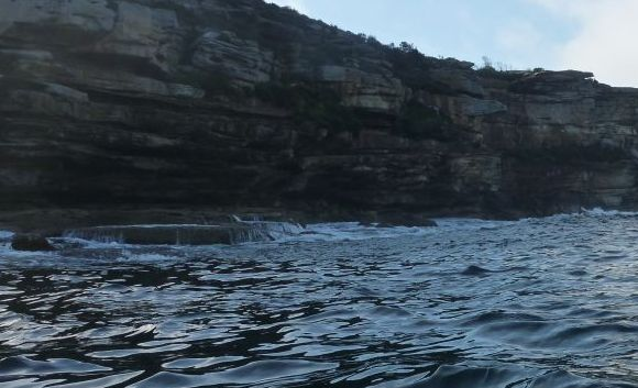 The south end of North Head. Cliffs and swirling water.