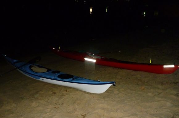Kayaks prepped and ready to set off into the darkness