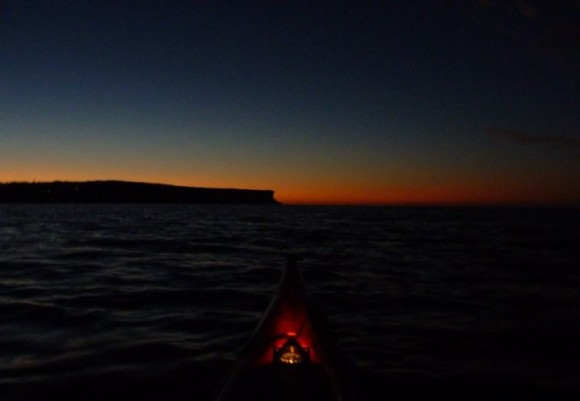 Paddling out to sea in the darkness