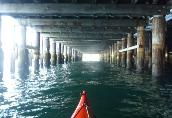 Paddling under Luna Park. Timbo surfed through this lane!