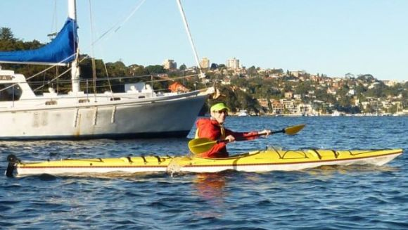 Mark traded in his usual Sit On Top for a sea kayak. Not sure about the lime visor though?