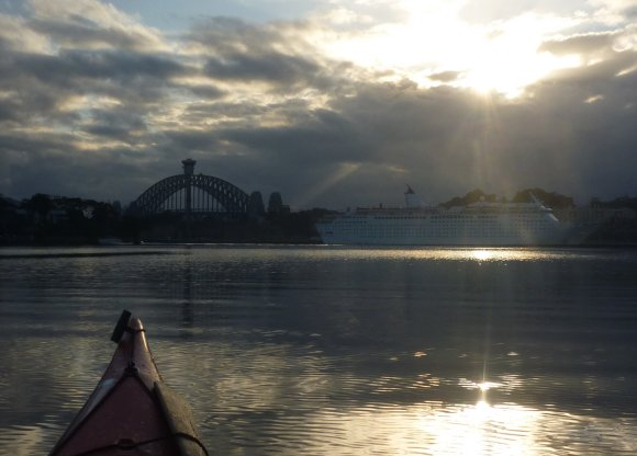 Breaking dawn over Sydney - golden skies and glassy waters