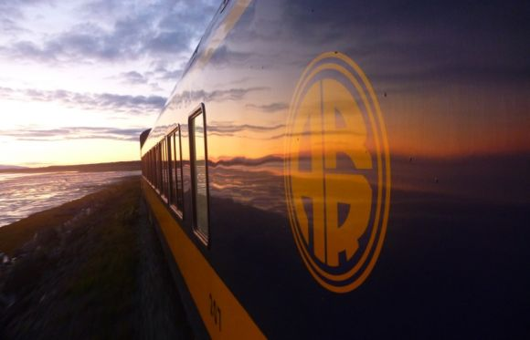 Hanging out of a moving train for an amazing sunset near Anchorage Alaska