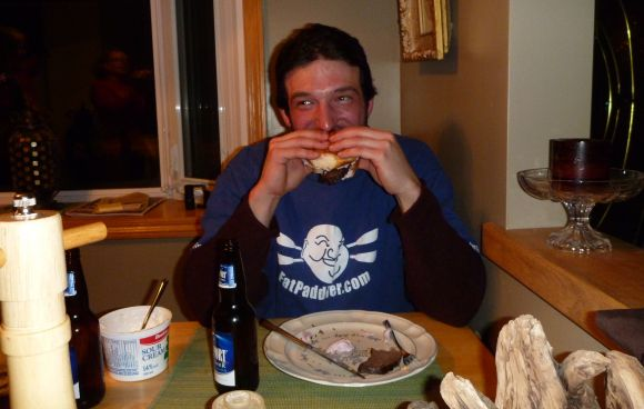 Seth eating a Persian deer burger. One of the grossest things I've ever seen!