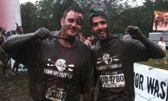 FP and Gelo, with Warrior Dash finishers medals.