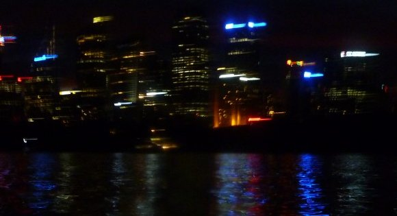 The lights of North Sydney reflected on the Harbour.