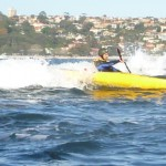 Lt. Gelo catches his first ever wave in a kayak. Nice!