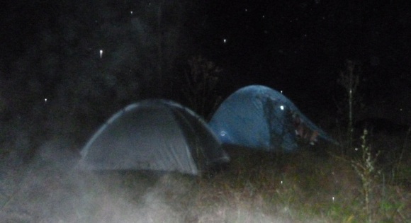 Tents set-up in the dark as the early fog closes in around us. Mikes was blue. Gelos was full of water!