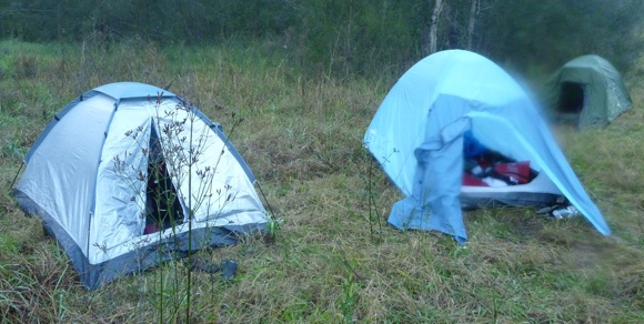 Tents in the morning. The silver one on the left filled with water!