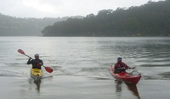 Swapping boats and playing in the rain on the flat waters of upper Middle Harbour