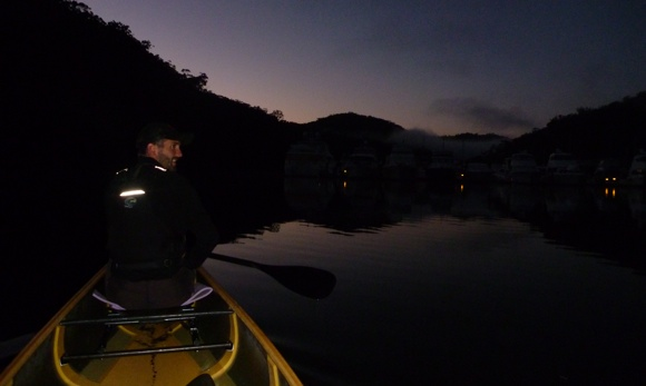 Travis surveying the water as we push off into the early morning's first light