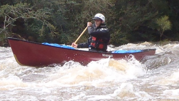 Travis of Paddle & Portage Canoes rides the Wenonah Rendezvous through rapids