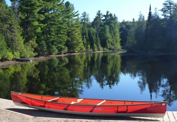 The Swift Keewaydin canoe at the put in to Rock Lake.
