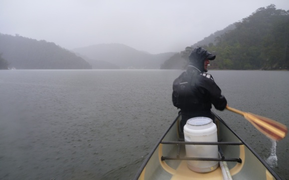 Travis in the bow, looking out through non-stop drenching rain