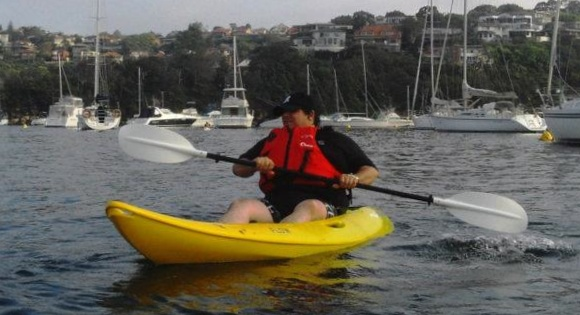 Frank learns about balance and paddle strokes on a Sit On Top surf kayak