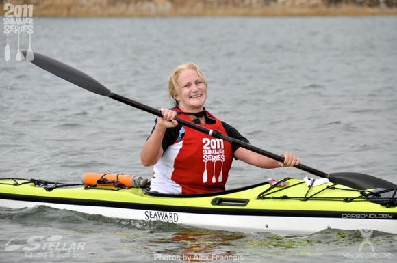 In the TFP kayak (female) division, Series leader Meg wins another race in her division!