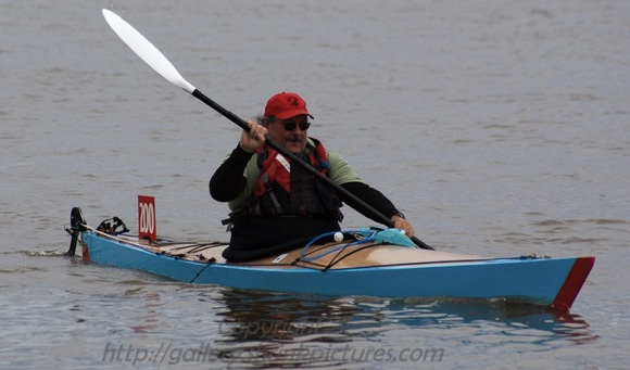 "Fellow competitor ""Bob"" in his stitch and glue timber kayak."