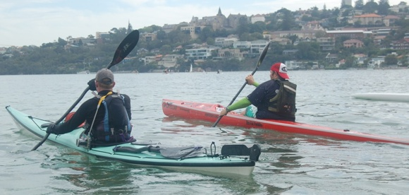 Jason and Fat Paddler paddle away from Rose Bay