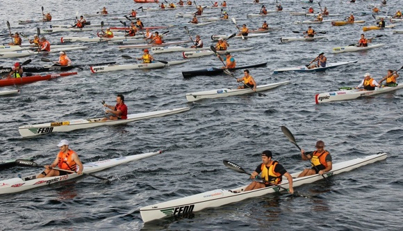 Hundreds of paddlers take part in the Bridge to Beach race each year