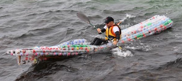 Tom Simmat from the Lane Cove River Kayakers in his recycled bottle boat.