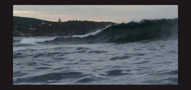 """The Dobroyd """"Bowl"""" with a southerly swell. Cliffs just to left of shot."""