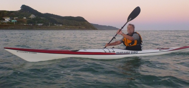 KASK paddler and event organiser John Hesseling playing at dawn on Raglan Harbour