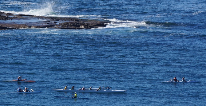 Local outriggers hit the water to take advantage of the easy ocean conditions