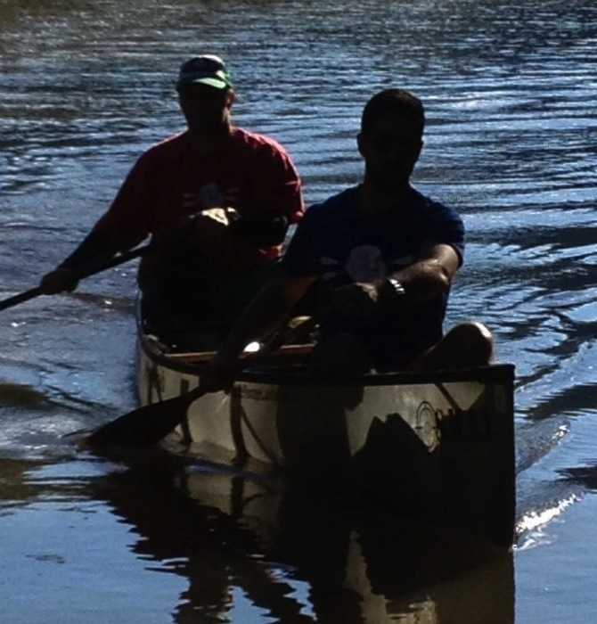 FP and Gelo sliding the canoe into the sandbar for a break