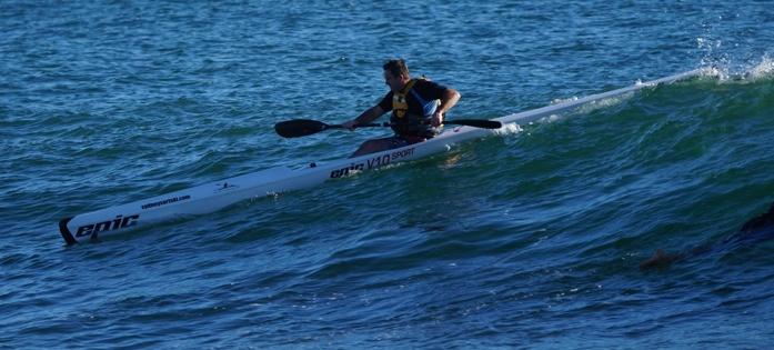 Darren charging a wave