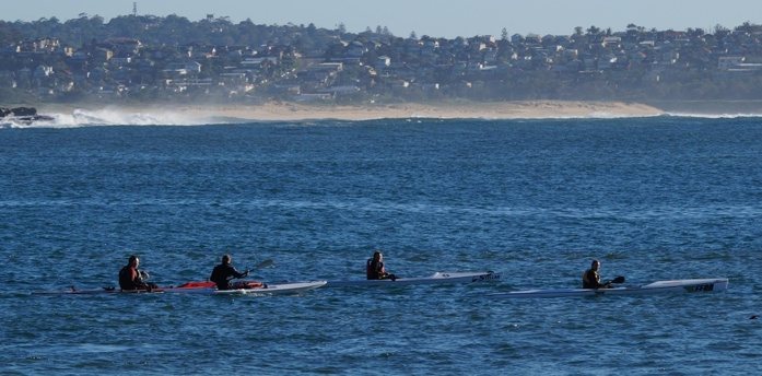 The Team Fat Paddler surfski crew paddling off Manly on a beautiful Autumn day