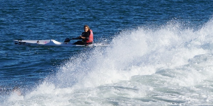 Tanya about to charge a lumpy wave