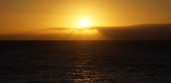 The sun rises over the Pacific Ocean