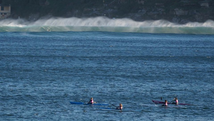 Manly SLSC surfski paddlers contemplating the paddle back through the surf