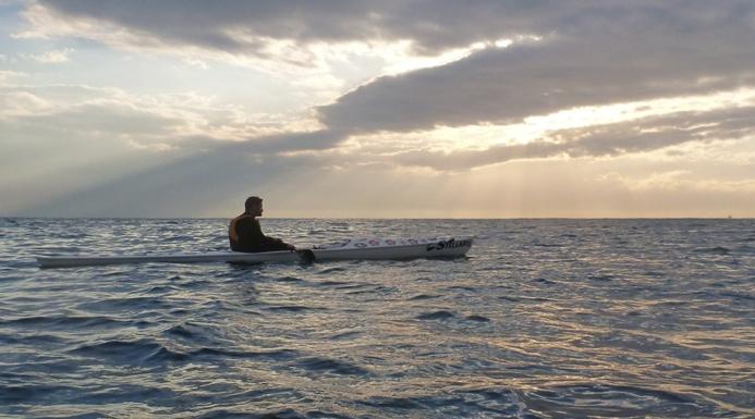 Nat awaiting the Manly sunrise from a Stellar SR surfski