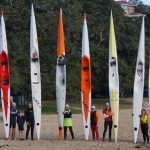 Blast paddlers pose for the stern to nose surfski shot