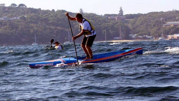 A SUP competitor riding the chop into Manly