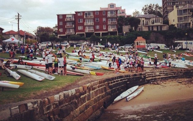 Paddlers gather at Blues Point for the race briefing